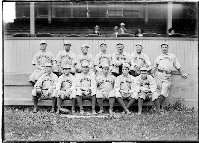 1902. Team portrait of the Cincinnati Reds, National League baseball team, sitting in front of the grandstand at the West Side Grounds. Chicago Daily News