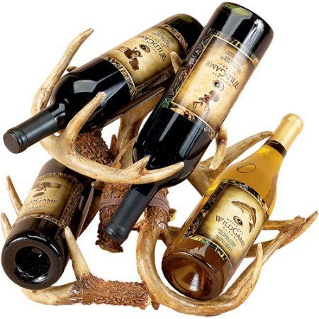 Decorative Wine Bottle Holder Rack Horns Shelving Storage Set.Showcase your love of the outdoors and nature with this Decorative Wine Bottle Holder Rack Horns Shelving Storage Set.It is constructed with polyresin material then hand-painted to mimic the look of the real thing.This decorative wine rack is suitable for storing multiple bottles of wine simultaneously.