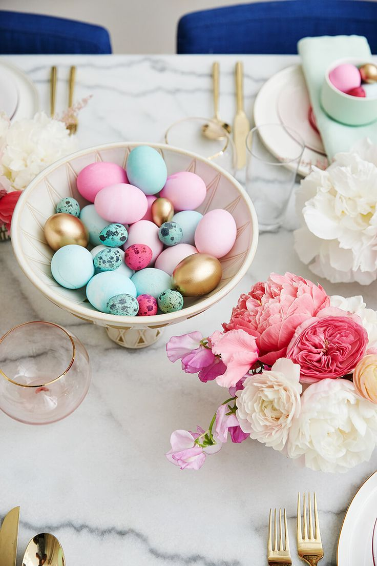 Loving these pops of color in Emily Henderson's Easter brunch spread -- especially the gold silverware and bold blue chairs.