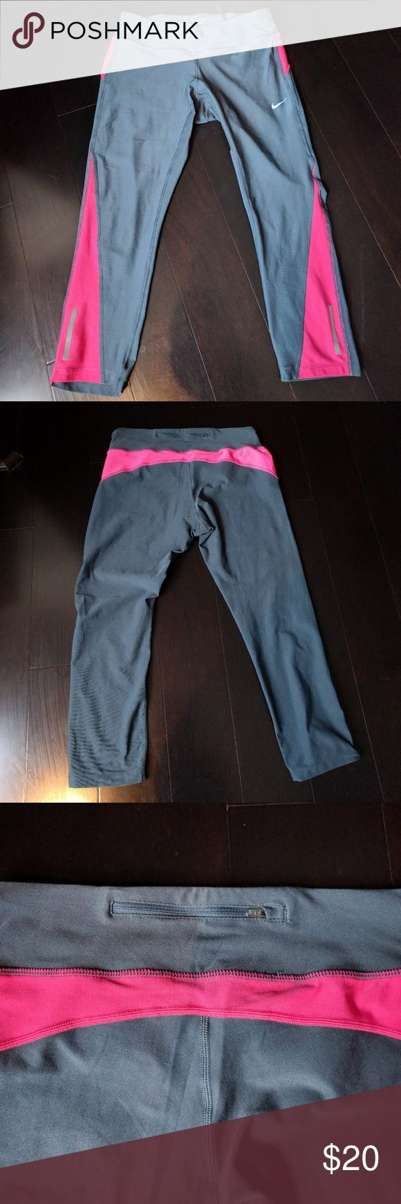 Nike Running Tights Super soft, DriFit leggings from the Nike Running line. Crop (below calf) length, drawstring, zippered key pocket, flat-lock seams, reflective strip for safety. Great condition. Nike Pants Leggings