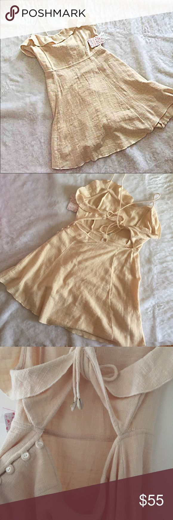 NWT free people medium beige mini dress Very nice style with shell details new with tags Free People Dresses Mini