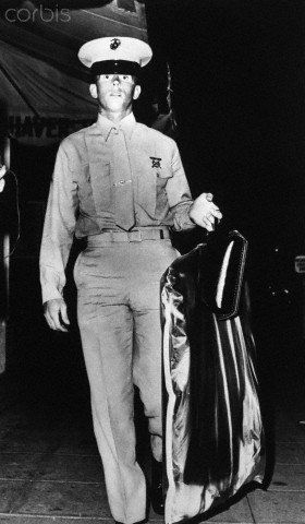 Joe DiMaggio Jnr arriving from his military academy school carrying the formal military dress he was to wear at Marilyn's funeral. August 1962