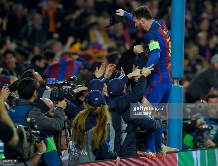 Barcelona's Argentinian forward Lionel Messi celebrates their victory at the end of the UEFA Champions League round of 16 second leg football match FC Barcelona vs Paris Saint-Germain FC at the Camp Nou stadium in Barcelona on March 8, 2017. /
