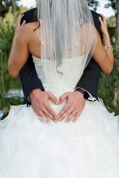 WEDDING PHOTOS  Mans hands making a heart on his ladies lower back <3