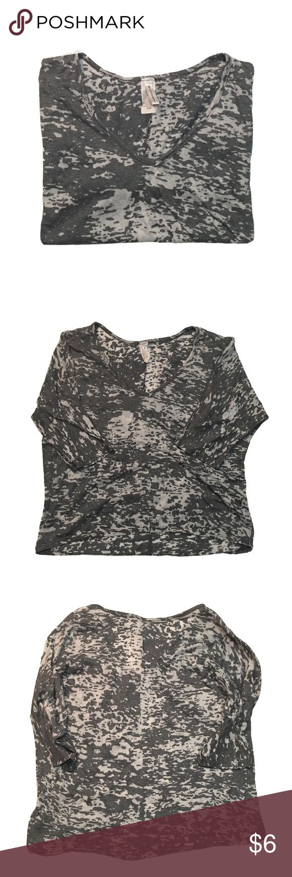 Grunge Top · Gray top bought from Marshall's. Grungy casual. Thin & lightweight. Loose elbow length sleeves. V-neck. Size medium petite - I'm a size small and it fits slouchy. Piling which isn't noticeable on the print. Used condition.   · These are photos of the actual item. Please review photos for flaws or signs of wear. I try my best to showcase and represent the true product. Tops