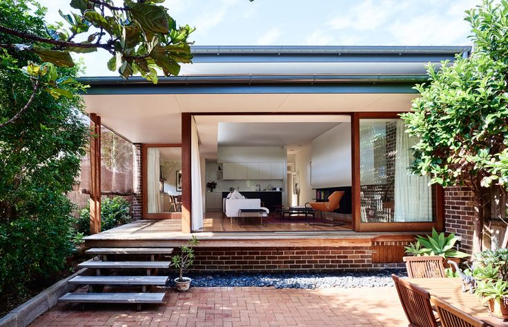 Timber doors; extended eave; exposed brick | Catherine Downie & Daniel North of Downie North Architects | The Design Files