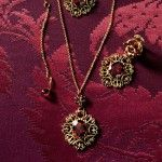 Gold filigree necklace and earrings with red garnets  - D