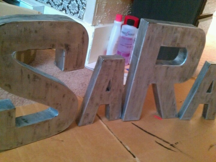 I made these faux metallic Anthropologie inspired cardboard letters!! SUPER SIMPLE and CHEAP. Cardboard letters from Pat Catans, covered in black craft paint, then two lighter coats of silver metallic craft paint! Love.
