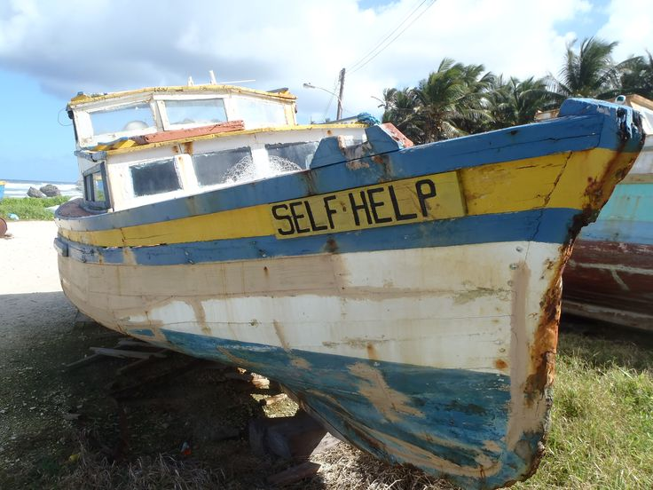 Derelict fishing boats left to rot in the sun at Bathsheba.