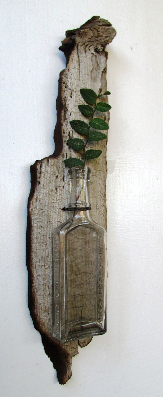 This rustic vase with a one of a kind vanilla extracts bottle is the perfect addition to your home. Check out SAUERS EXTRACTS still written on