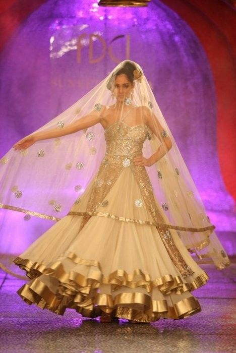 GHAGRA -A traditional Indian skirt widely flared, often made up of several triangular panels stitched together to add even more flare. (Rudrakshi Johar FMM1B2)