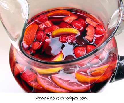 Sangria (love!) -   1 orange, cut into 1/8-inch slices  1 lemon, cut into 1/8-inch slices  1 cup granulated sugar  1 (750 ml) bottle dry white wine  1 (750 ml) bottle dry red wine  Sliced peaches, grapes, strawberries, or other seasonal fruit  Gin, Grand Marnier, or brandy to taste (I did 4 shots of Grand Marnier)