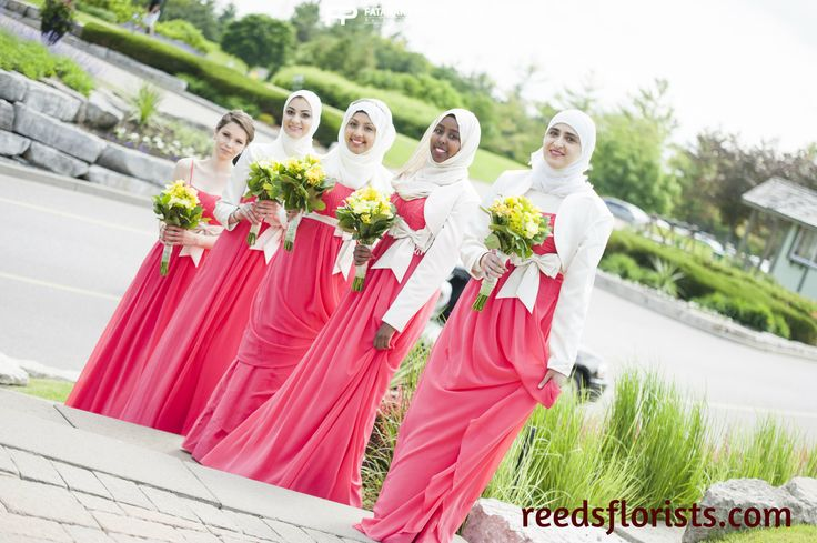 Pretty yellow flowers bring summer colour to this bridal party. www.reedsflorists.com