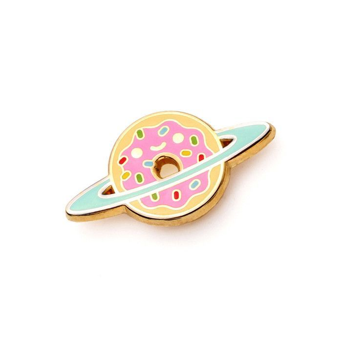 An out of this world enamel pin! - Pin measures about 1.25 x .75 in. - Hard enamel with rubber clasp. - Gold and silver plating. - Designed by 100% Soft.