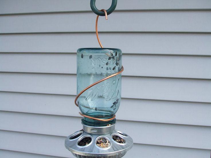 Aqua Ball Mason Jar Birdfeeder with copper-Hanging. $13.95, via Etsy.