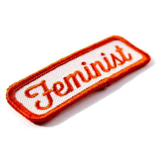 "Yes all women Embroidered patch with merrowed edge Iron-on adhesive backing Measures 1"" tall x 3"" wide"