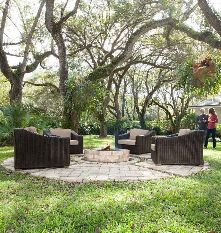 Four outdoor wicker chairs + fire pit = cozy backyard entertainment set
