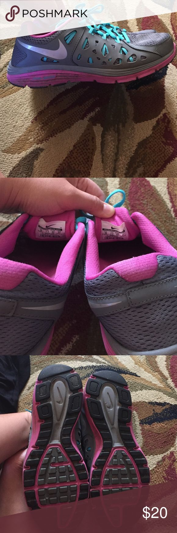 Used condition Nike Dual Fusion Tennis Shoes Nike dual fusion Tennis Shoes in good used condition. They have dirt stains on the bottom purple part and slightly on the mesh part of the right shoe. Not noticeable at all. These have lots of life left! Nike Shoes Athletic Shoes