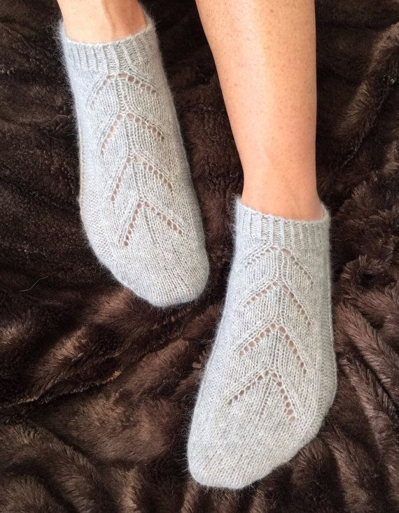 Designed & hand made in Hampshire, England. I initially designed these gorgeous cashmere footsie socks after a request from my closest friend who wanted a pair of cashmere socks she could wear over tights & with a pair of boots. Since then theyve become one of my best sellers! Theyre also perfect for wearing in a shoe with bare legs. They are made from a beautifully soft luxurious pure cashmere yarn and are knitted on four very fine needles so are totally seamless and take over 6 hou...