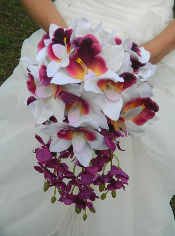 love this! Absolutely beautiful and so different. Orchid wedding bouquet.