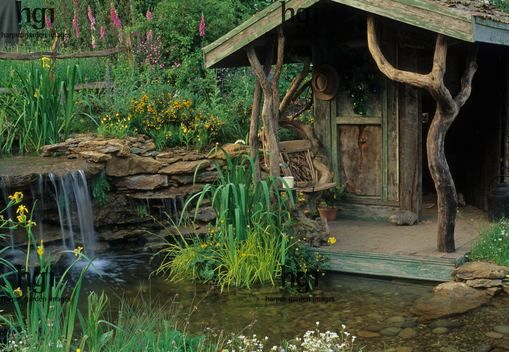 Harpur garden images mc215 garden building beside shallow wildlife pond fed by small - Build pond wildlife haven ...