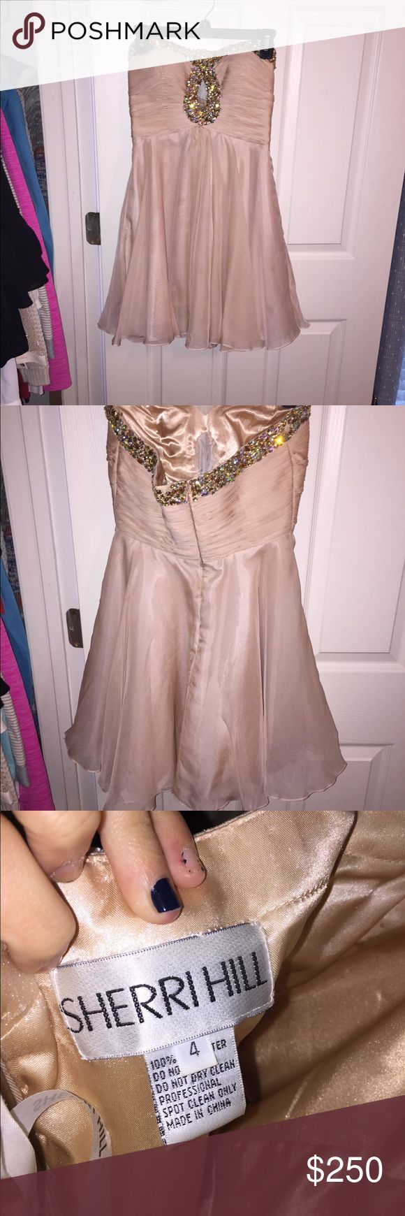 BLUSH SHERRI HILL HOMECOMING DRESS Worn once! Perfect condition! Sherri Hill strapless homecoming dress with mesh cutout. Blush color. Sequined along the top. Price negotiable Sherri Hill Dresses Mini