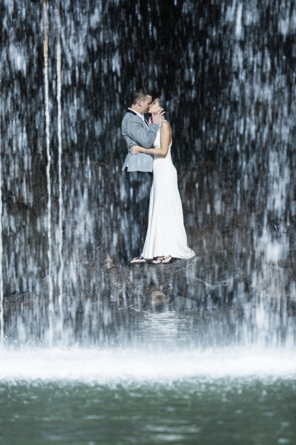 Gorgeous post-wedding photograph under a waterfall in #Maui Photography By / trishbarkerphotography.com