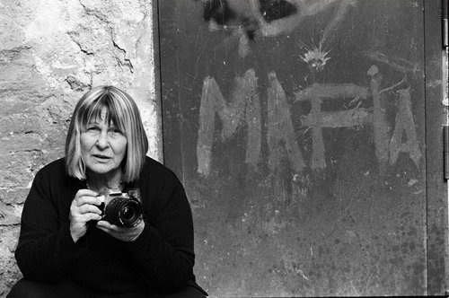"""Letizia Battaglia is a Sicilian photographer and photojournalist. Although her photos document a wide spectrum of Sicilian life, she is best known for her work on the Mafia. She also became involved in women's and environmental issues. For several years she stopped taking pictures and officially entered the world of politics. From 1985 to 1997 she held a seat on the Palermo city council for the Green Party. She was instrumental in saving and reviving the historic center of Palermo."""