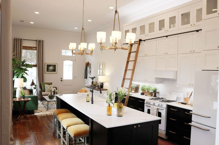Shotgun house renovated. Moved bedroom to back and opened up the living and kitchen area. Waypoint Living Spaces |