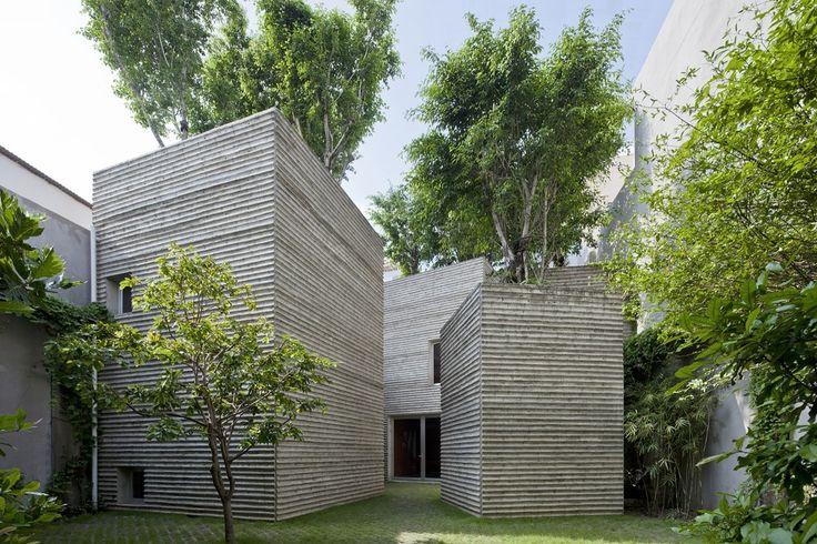 Des arbres sur des maisons écologiques à Ho-Chi-Minh-Ville au Vietnam