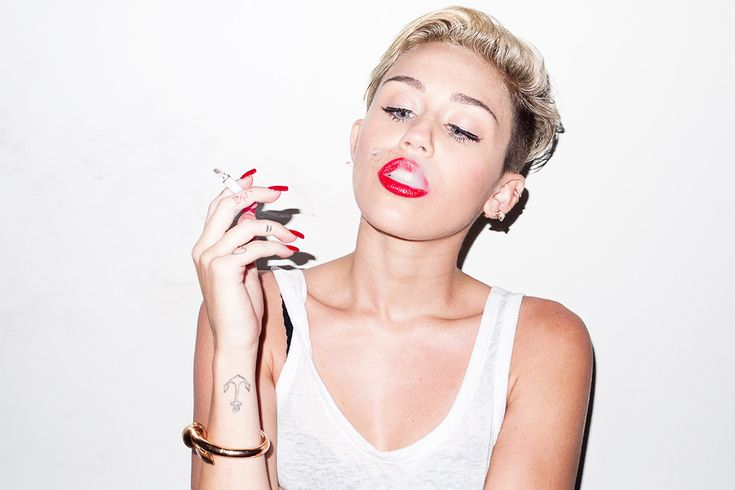 "Miley Cyrus><><>< Its a love/hate relationship with this chick! lol I love her sometimes and then other times Im like ""WTF miley......???"" LOL"