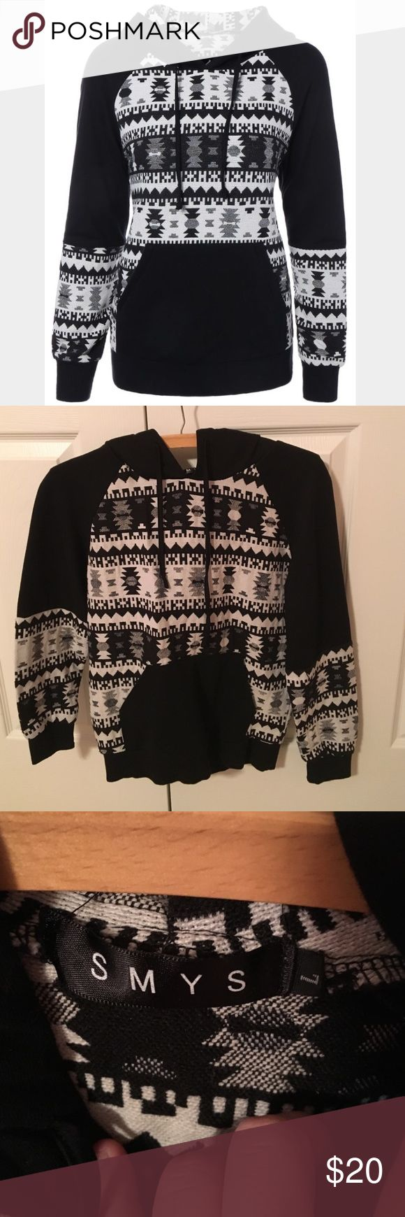 Black and White Aztec Hoodie Black and White! Aztec pattern throughout! It's a size Large but it fits like a Small! Tried it on once and didn't like the fit! No trades! Open to Offers! Tops Sweatshirts & Hoodies