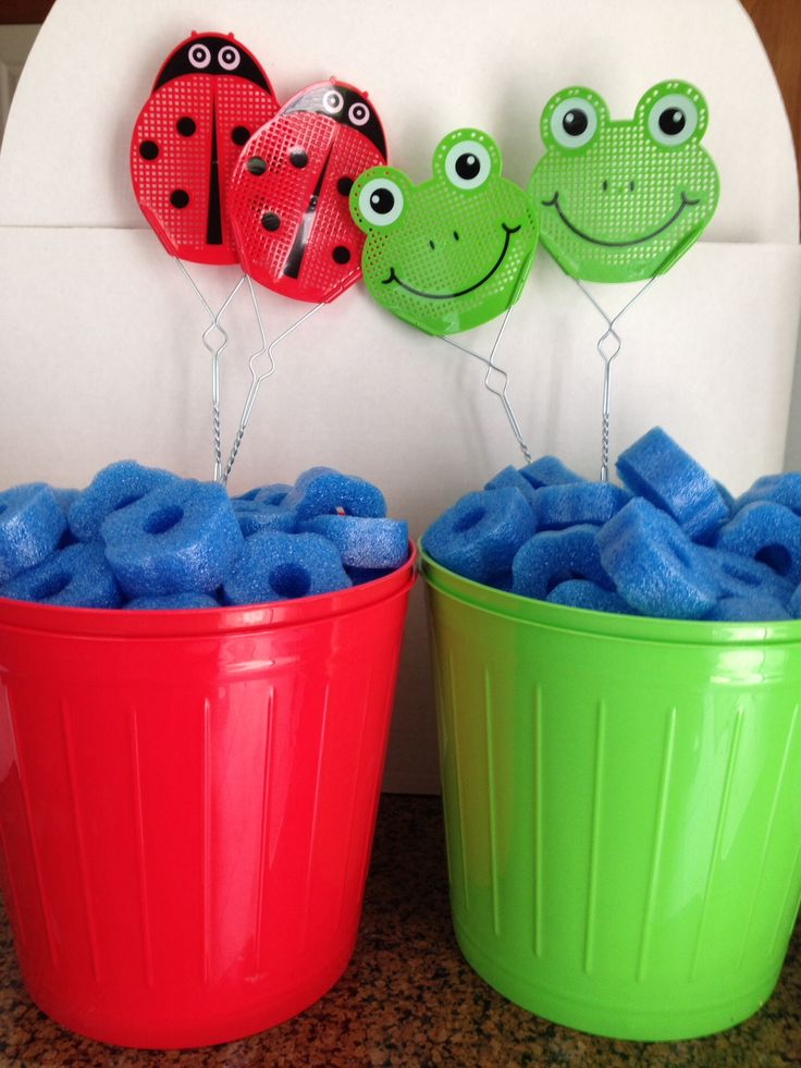 """Dollar Store relay game.  Frogs vs. Ladybugs - which team can move the most """"water"""" (slices of pool noodle) in 5 min?     Materials: 2 red buckets, 2 green buckets, 2 ladybug fly swatters, 2 frog fly swatters, 3 pool noodles cut into slices w/ bread knife (approx. 150).  Total cost $11  Reusable."""