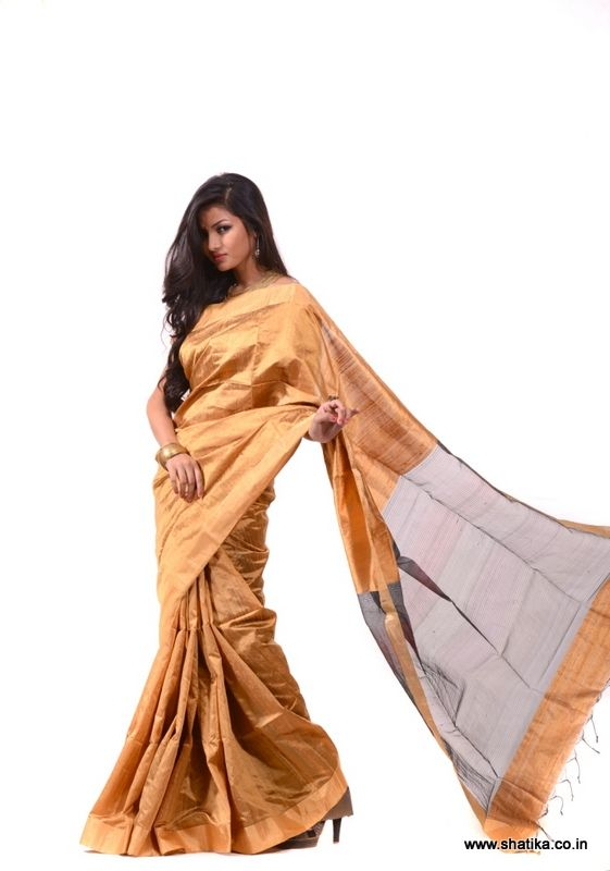 A pure handloom saree themed around fancy plain-body concepts of Banaras, Mehul plain body dupion silk saree is in line with today's fashion which believes in keeping it simple. The shout out point of this plain silk saree is its sheer pallu! If you are somebody who likes it plain, then this is your perfect choice.