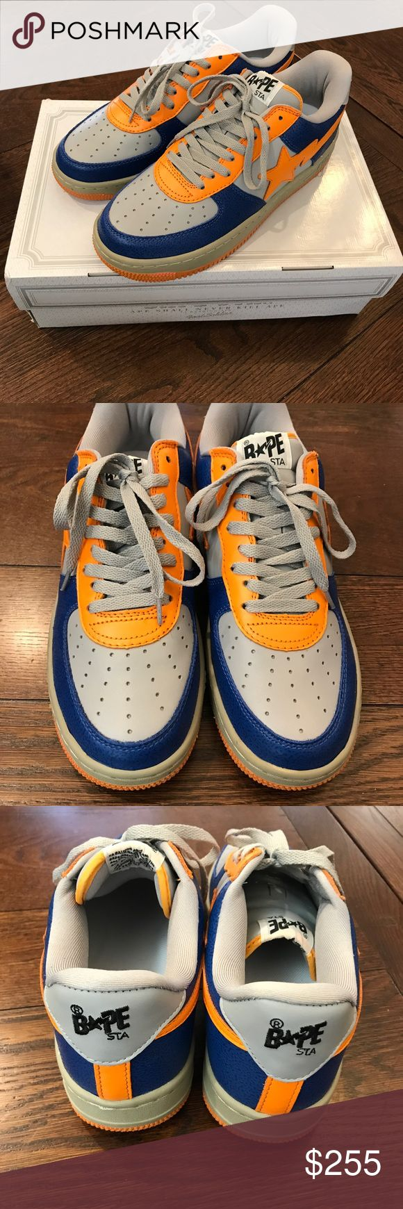 Bape Orange and Blue Leather Bapesta Sneakers For sale is a barely used pair of Bape Bapesta model sneakers in blue, orange, and grey leather. Originally purchased at the Bape store in NYC in the summer of 2013. No toe box creases, chipped insole logo, and faded outsole stars due to being worn less than 5 times. Some manufacture defects such as white stitch and tiny chipping of outsole (see last picture). Original box with secret inside detail panel included. Message if any questions. Bape…