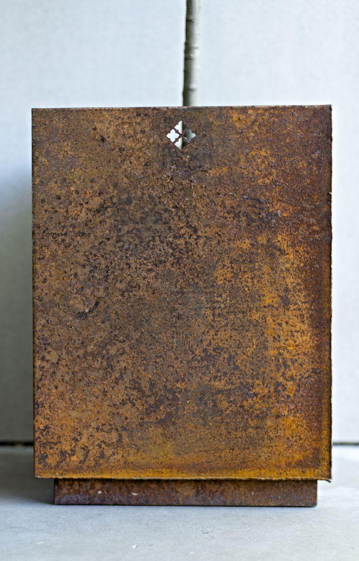 Corten steel meets concrete.