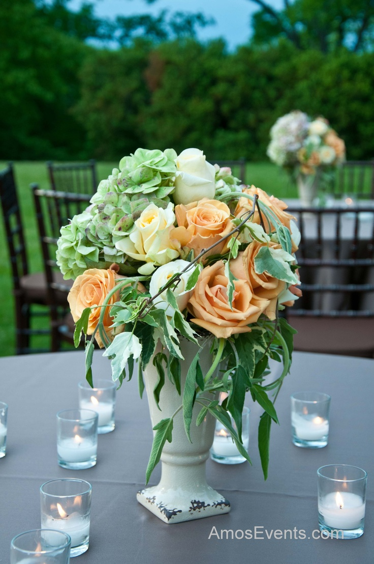 Centerpieces of green hydrangea soft yellow and coral
