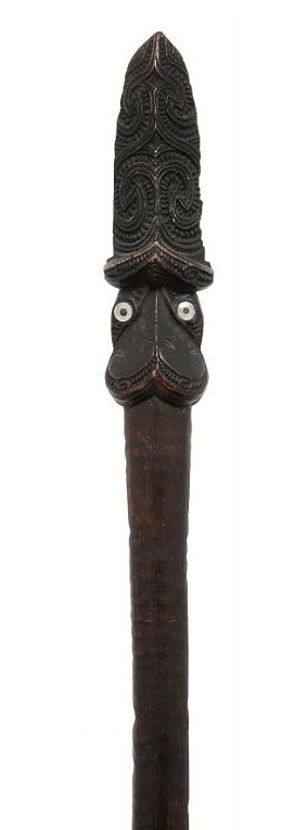 A RARE MAORI TAIAHA   18TH/19TH CENTURY   Of one piece of hardwood, comprising long flat blade (ate) widening towards the tip, and carved head (upoko) with short carved tongue (arero)  60½in (153.7cm) overall