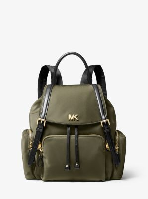 The perfect size for day-to-day essentials, our Beacon backpack boasts a lustrous nylon shell that's accented with leather straps and sleek hardware. Multiple exterior pockets and a top handle offer maximum versatility.