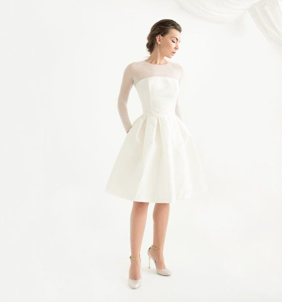 Our newest long sleeve knee length wedding dress - Lotta - marries modernity and femininity perfectly. Designed for the bride who loves