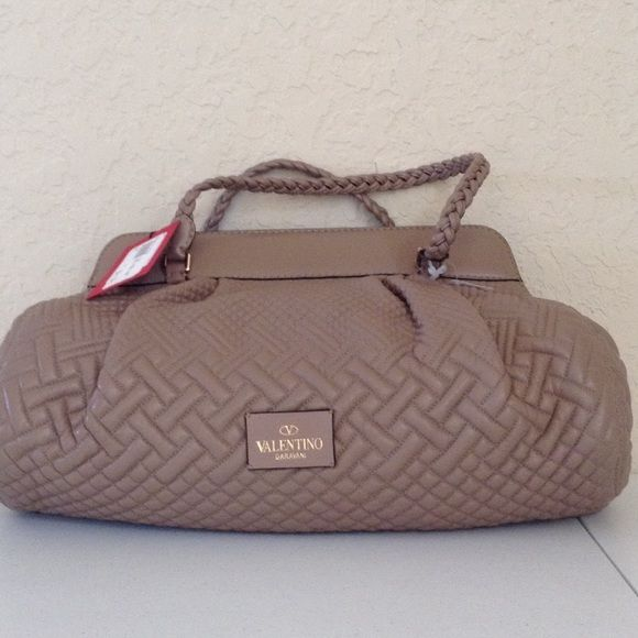 """Valentino Garavani leather purse NWT Item DW800324-ANT801 MSRP 2,795.  Dark Beige quilted with braided handles with red Valentino patch inside. Made in Italy. 17/9/7"""" tiny discoloration from storage and 2 indents on leather from storage not noticeable unless you are looking for it and the bag is 6 inches from your face. Valentino Bags"""