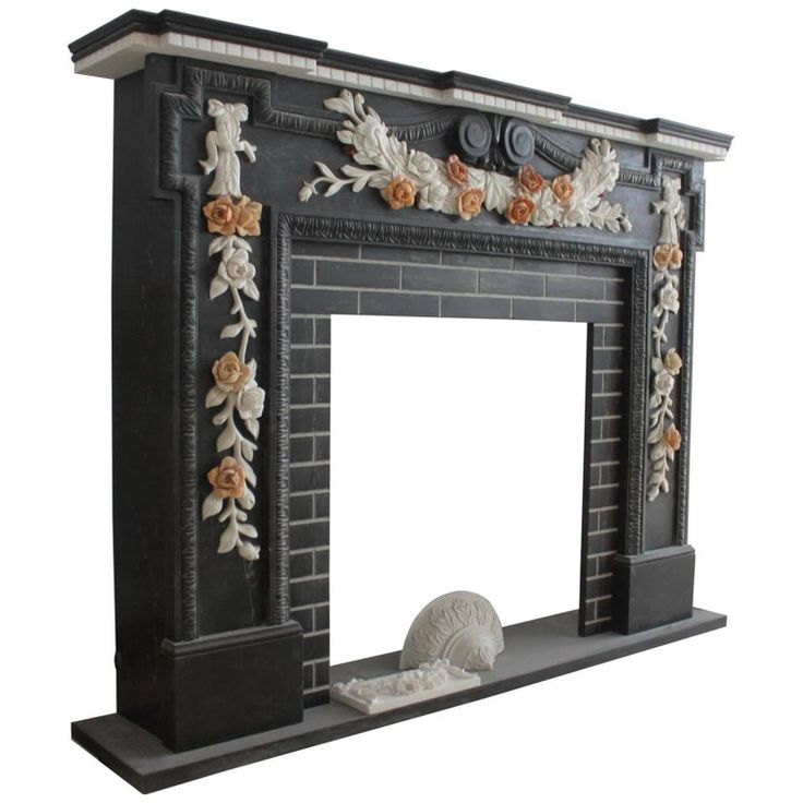 Very Heavy Black and White Marble Fire Surround with Floral Carving | From a unique collection of antique and modern fireplaces and mantels at https://www.1stdibs.com/furniture/building-garden/fireplaces-mantels/
