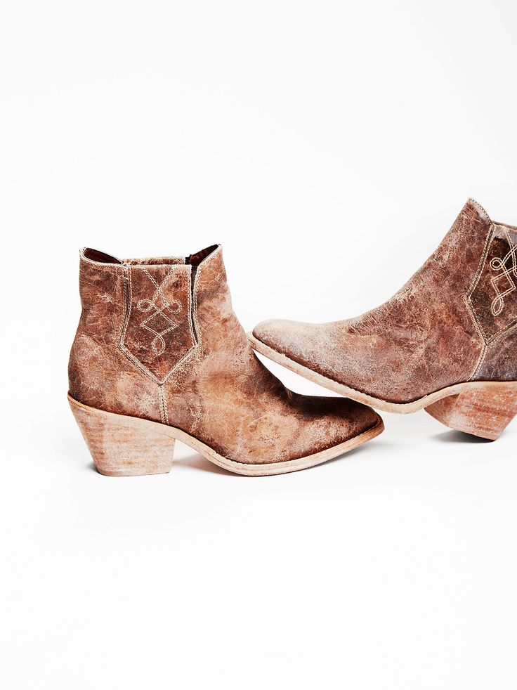 Williams Ankle Boot   Western-inspired ankle boots featured in a distressed worn-in leather. Side goring for an easy fit with embroidery detailing. Stacked heel. Sizing Tip: This style runs small, we recommend sizing up.