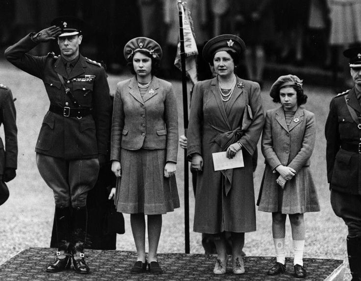 King George VI, (1895 - 1952) Queen Elizabeth, Princess Elizabeth (Queen Elizabeth II) and Princess Margaret (1930 - 2002) inspecting the Grenadier Guards (who are not visible) on Princess Elizabeth's 16th birthday