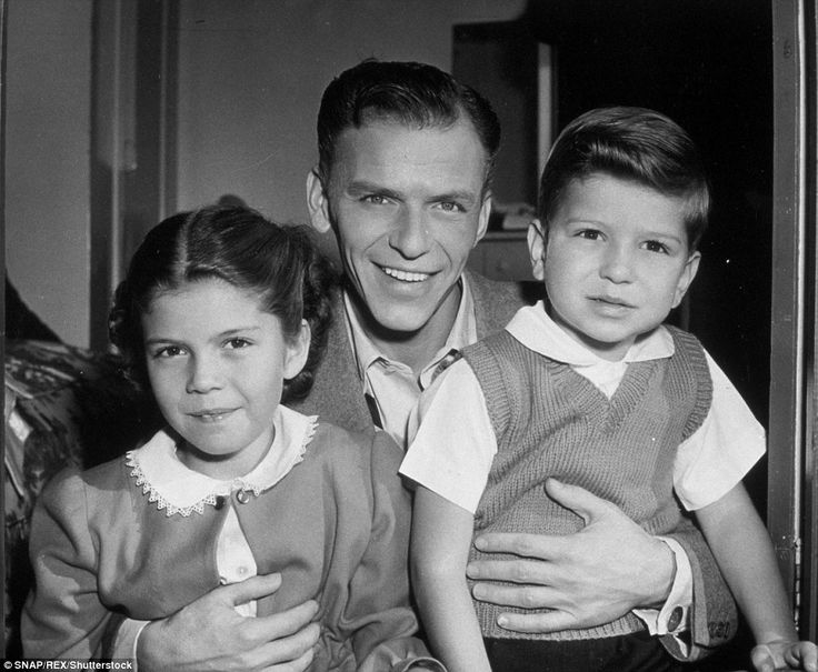 A young Frank Sinatra Jr. (right) is pictured in the arms of his father and sister Nancy J...