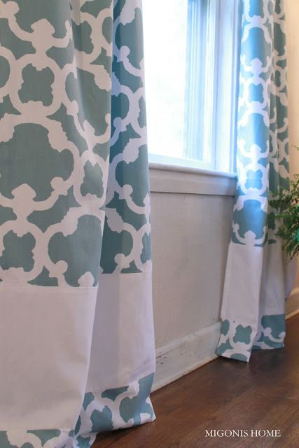 Banded curtains made from Target shower curtains.  Cut the curtains near the bottom and sew a white band in between the two pieces.  Migonis Home: Makeover Monday: Living Room Windows
