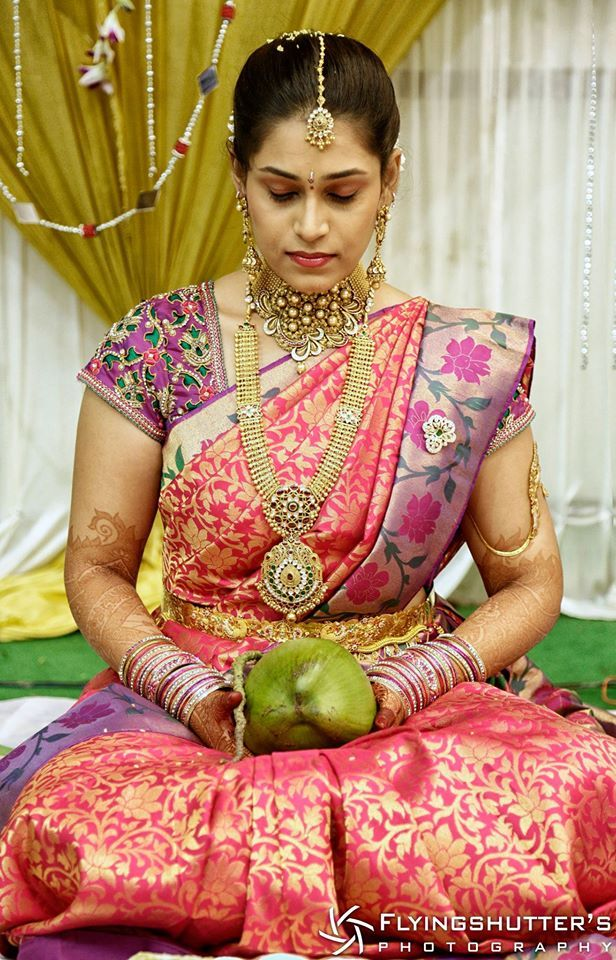South Indian bride. Temple Indian bridal jewelry. Jhumkis.Pink silk kanchipuram sari.Braid with fresh jasmine flowers. Tamil bride. Telugu bride. Kannada bride. Hindu bride. Malayalee bride.Kerala bride.South Indian wedding.