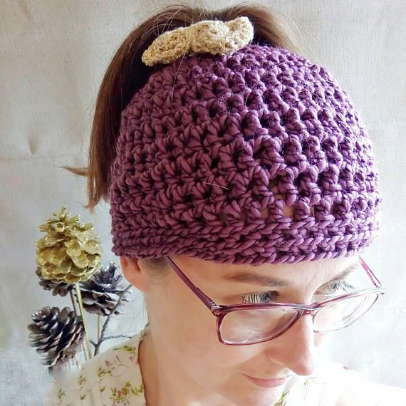 Check out this item in my Etsy shop https://www.etsy.com/uk/listing/527136058/purple-crochet-ponytail-hat-messy-bun