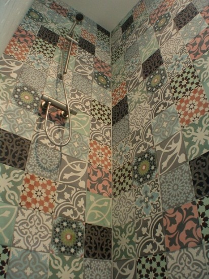 patchwork tiles used floor to ceiling in different colours but using the same tone. give an eclectic feel.