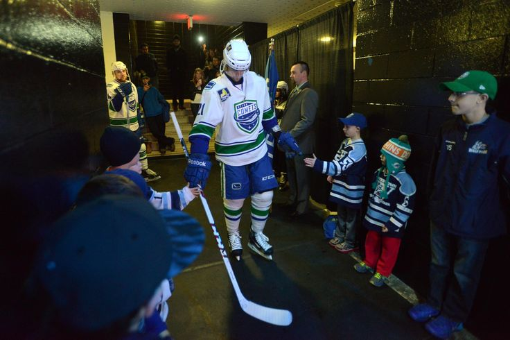Tina Russell / Observer-Dispatch The Utica Comets players high-five kids before entering onto the ice to play against the Lake Erie Monsters during AHL hockey at the Utica Memorial Auditorium Saturday, Dec. 27, 2014. Comets won 6-3.  Read more: http://www.uticaod.com/photogallery/NY/20141227/PHOTOGALLERY/122709999/PH/116_169_337_629_1640_1641_1651?refresh=true#ixzz3ND7hWb1k